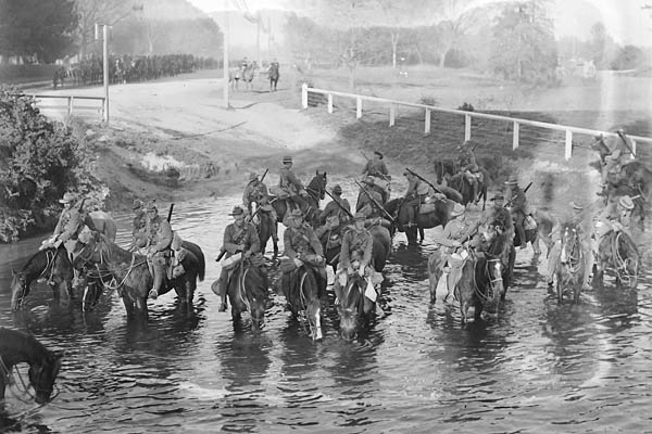 The Canterbury Mounted Regiment on its march to the troopships watering horses in the River Avon, Near Carlton Bridge, Christchurch.